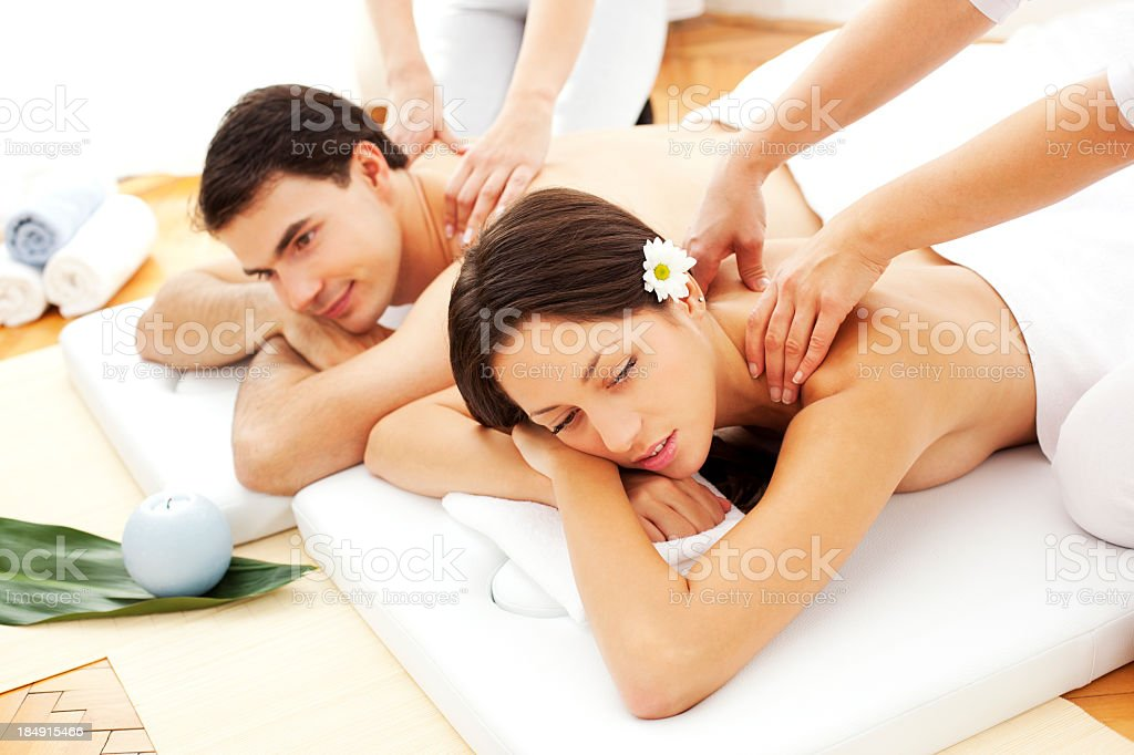Couple Having Massage At Spa Center royalty-free stock photo