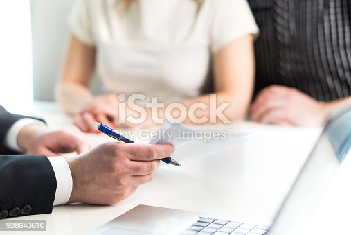 istock Couple having meeting with legal advisor, real estate agent, businessman or banker. 938640610