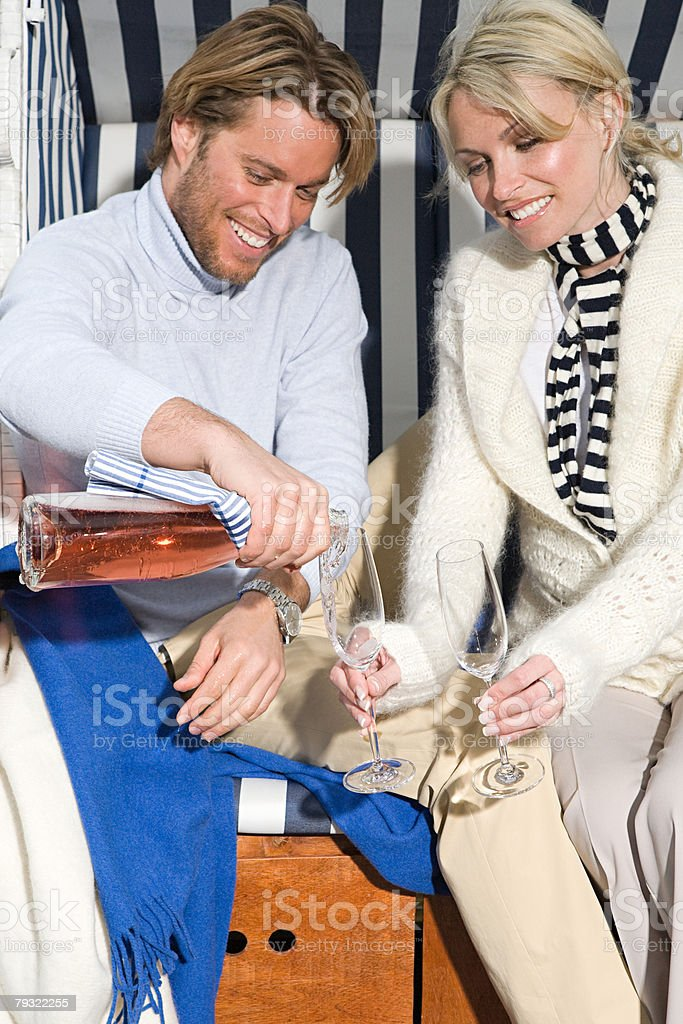 Couple having pink champagne royalty-free 스톡 사진