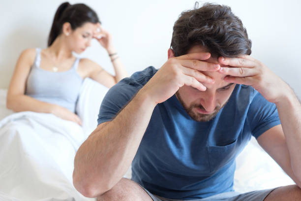 Couple having problem and feeling sad after big argument Man sad after arguing with his girlfriend in the bed relationship difficulties stock pictures, royalty-free photos & images