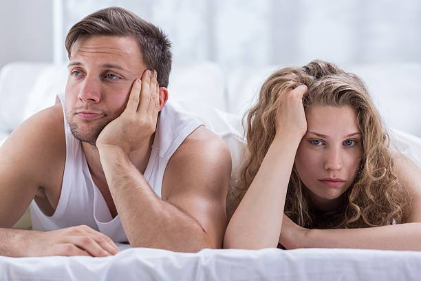 Couple having problems in bedroom stock photo
