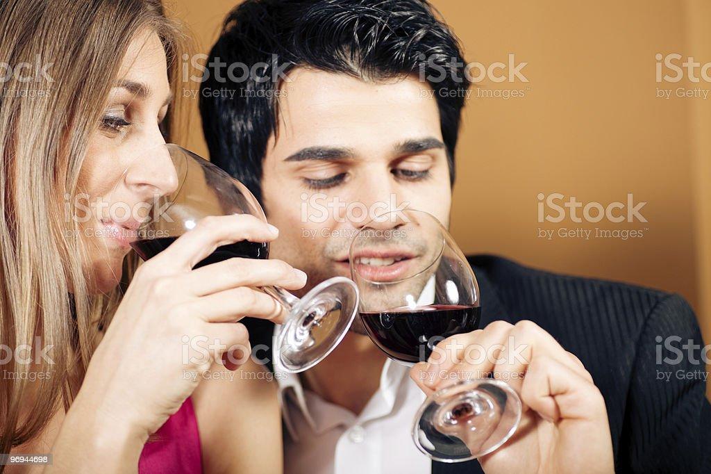 Couple having red wine royalty-free stock photo
