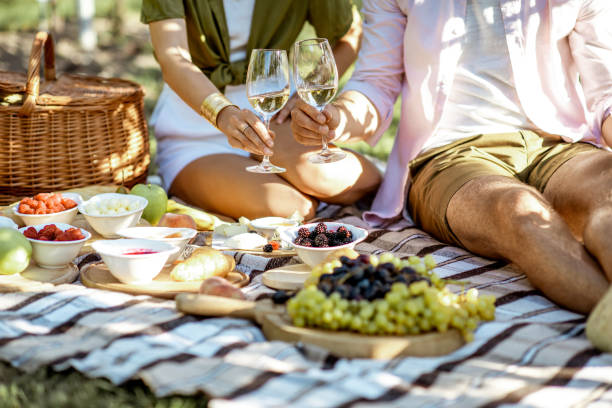 Couple having romantic breakfast outdoors stock photo