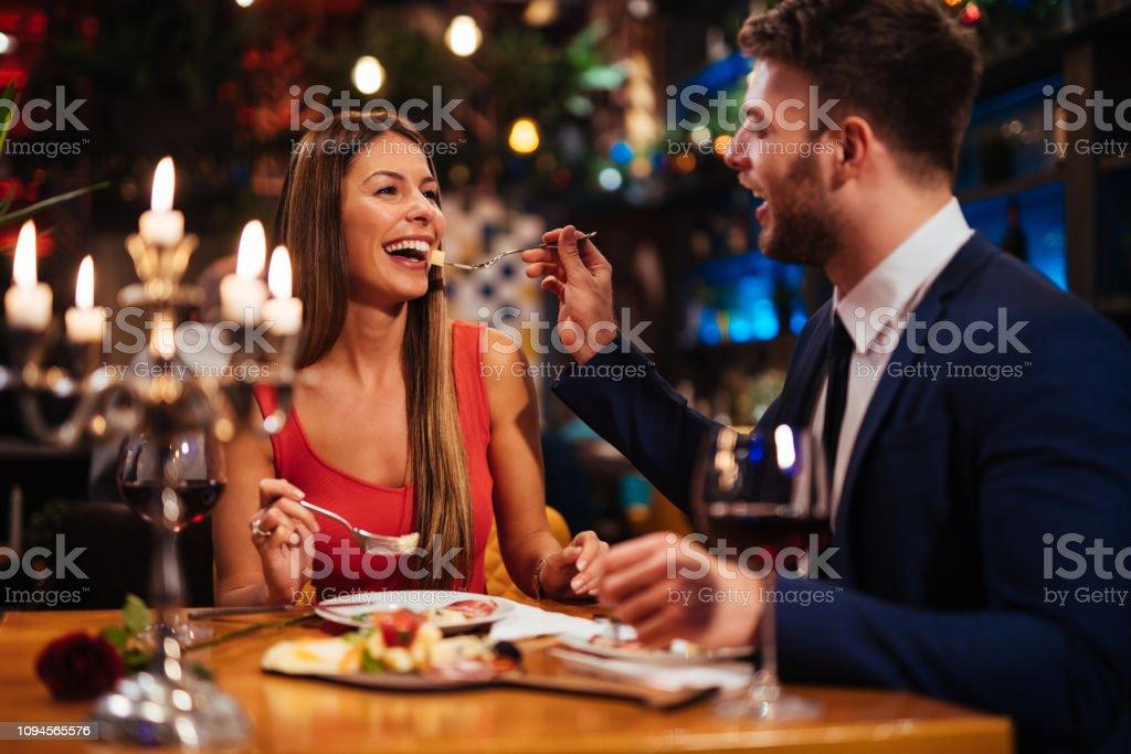 Couple having romantic dinner in a restaurant stock photo