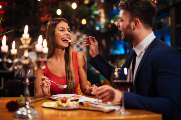 Couple having romantic dinner in a restaurant Couple having romantic dinner in a restaurant table for two stock pictures, royalty-free photos & images