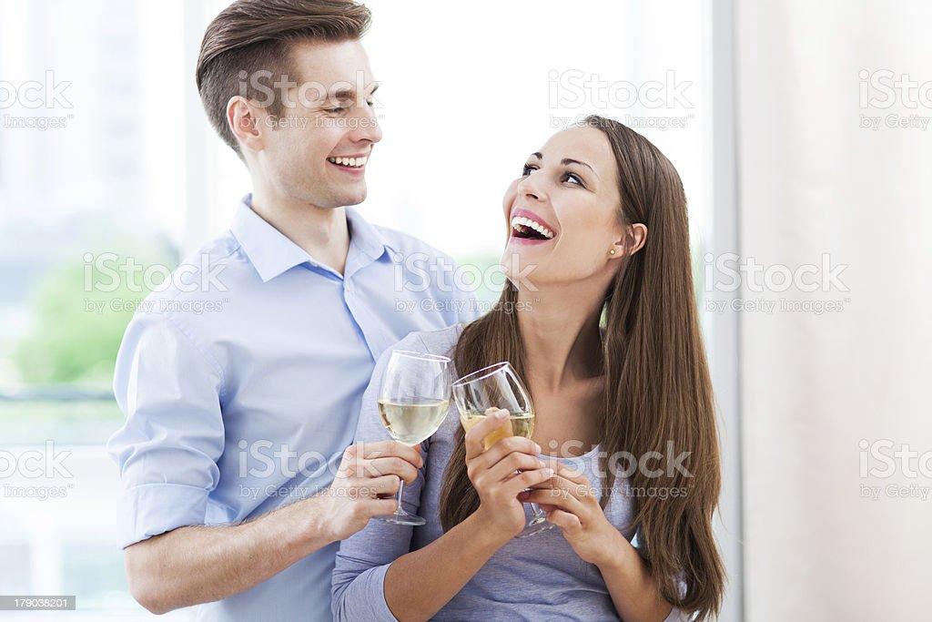 Couple having toast in new home royalty-free stock photo