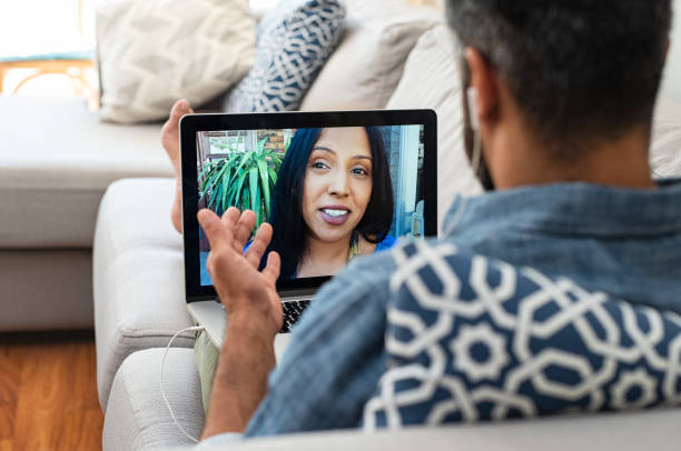 Couple having video call Closeup of woman talking through video chat on laptop with her boyfriend. Mature man communicating with his mixed race girlfriend on laptop in video chat. Man and woman talking to each other through a videocall on a laptop. long distance relationship stock pictures, royalty-free photos & images
