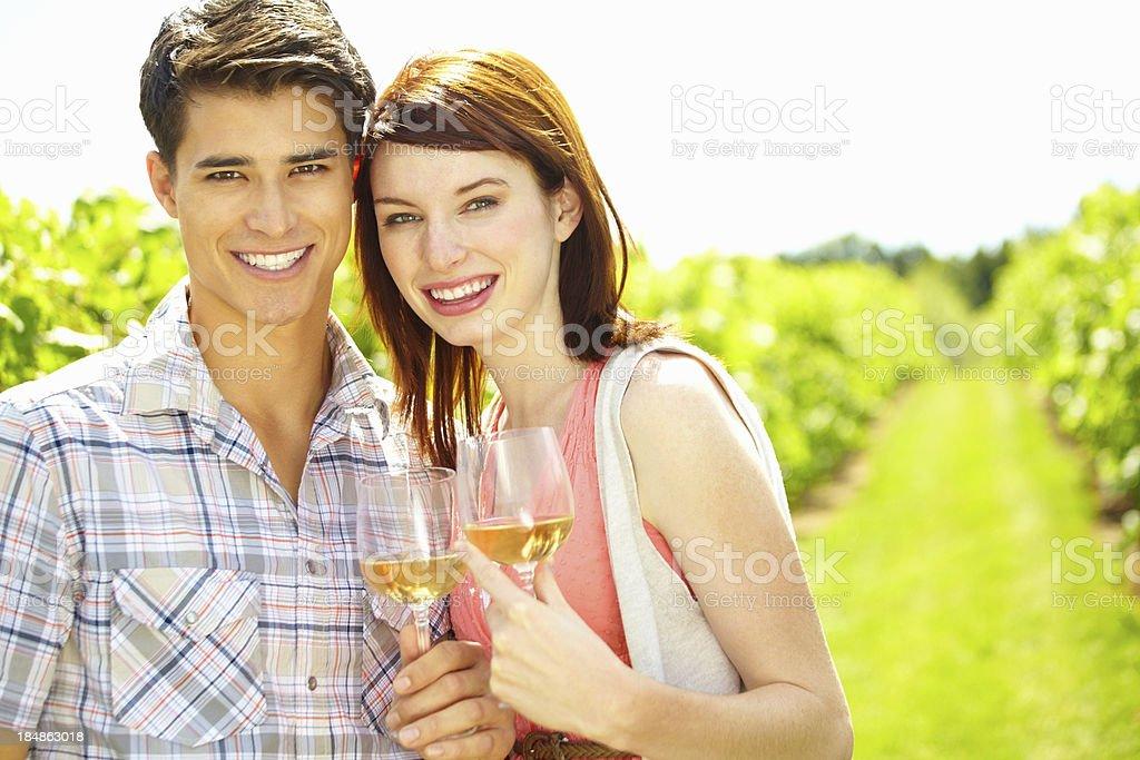 Couple having white wine in vineyard royalty-free stock photo