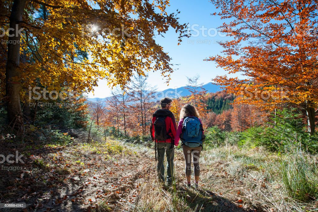Couple hikers enjoying beautiful scenery on valley stock photo