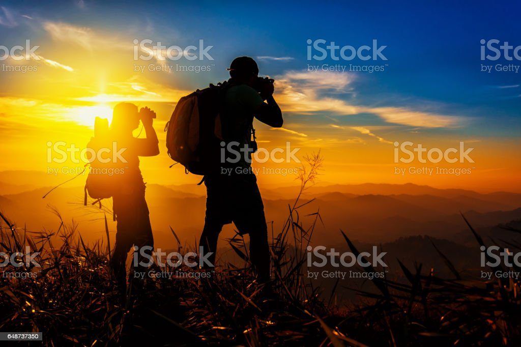 couple hikers on the top of mountains stock photo
