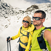 Couple hikers man and woman doing selfie portrait in winter mountains. Inspiration and motivation in beautiful landscape. Trekking and climbing partnership in Himalayas, Nepal, Annapurna Range.