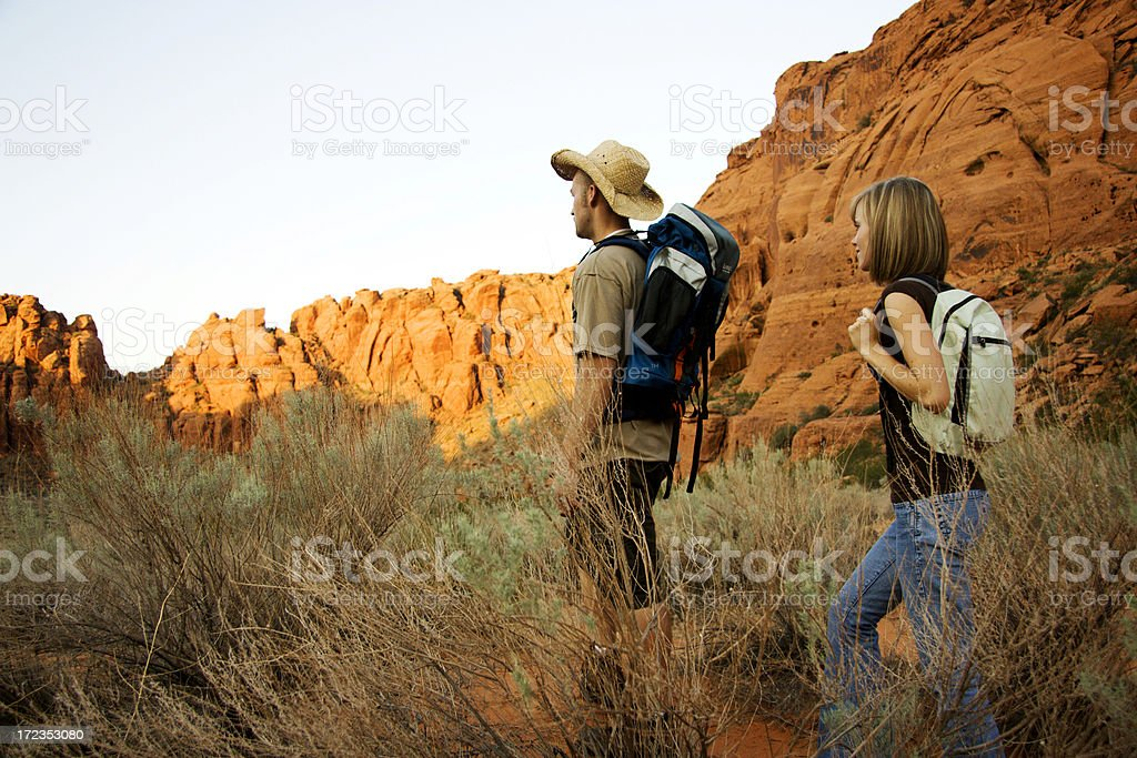 Couple hiking a Trail at Dawn royalty-free stock photo