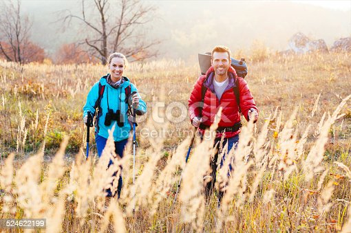 istock Couple hiking during sunset 524622199