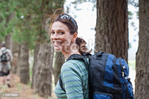 istock Couple hiking in forest 170576691