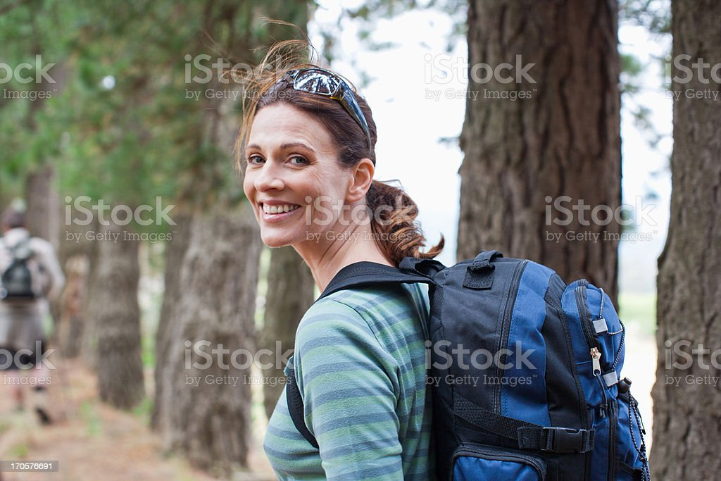 Couple hiking in forest stock photo