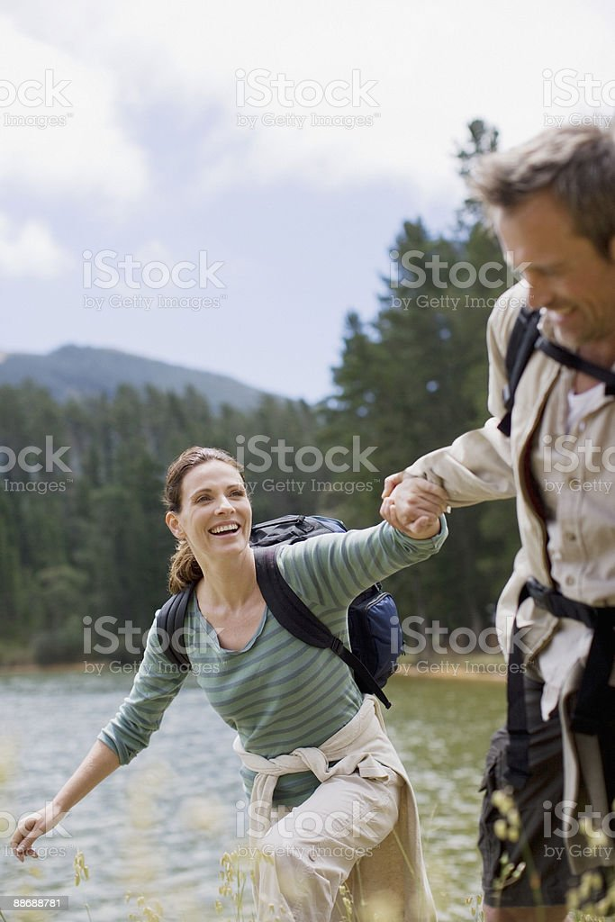 Couple hiking near lake in remote area royalty-free stock photo