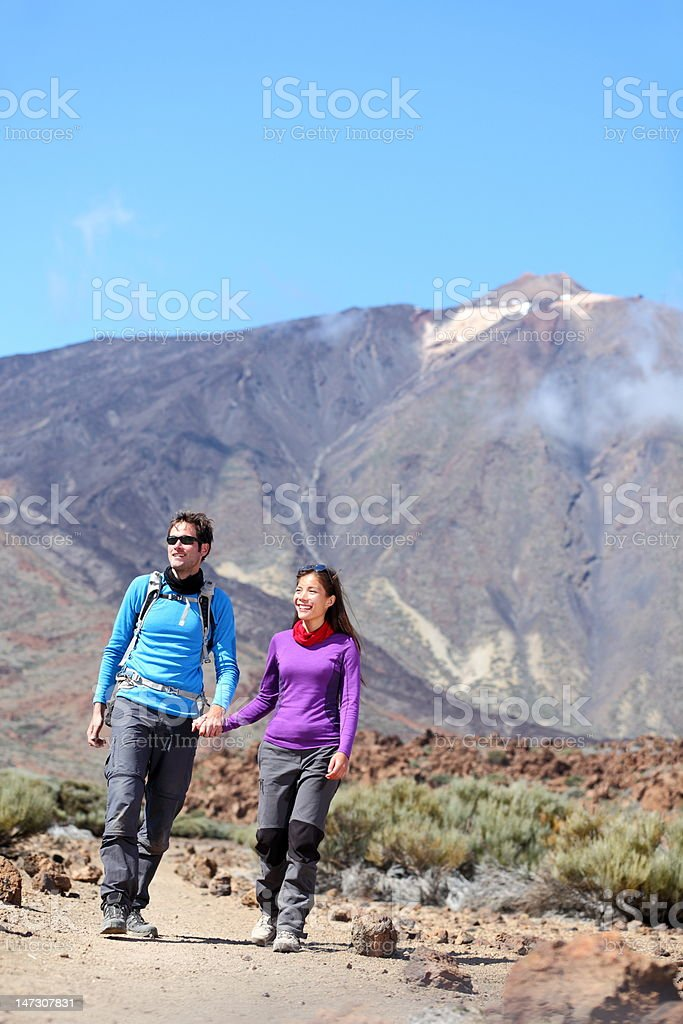 Couple hiking outdoors royalty-free stock photo