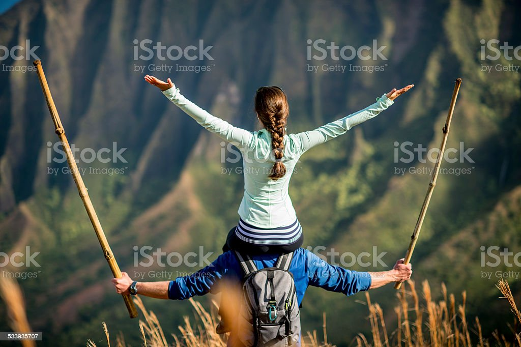 Couple hiking while on vacation in Hawaii stock photo