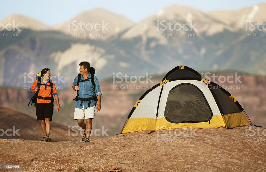 Couple Hiking With Backpacks In La Sal Mountains royalty-free stock photo