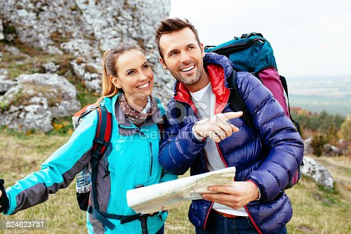 istock Couple hiking with map 524623731