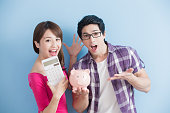 istock couple hold pink pig bank 653287934