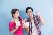 istock couple hold pink pig bank 653291520