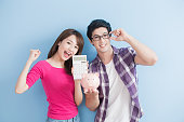 istock couple hold pink pig bank 653814930