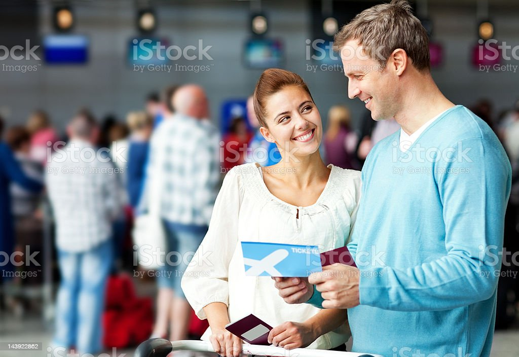 Couple Holding a Boarding Pass royalty-free stock photo