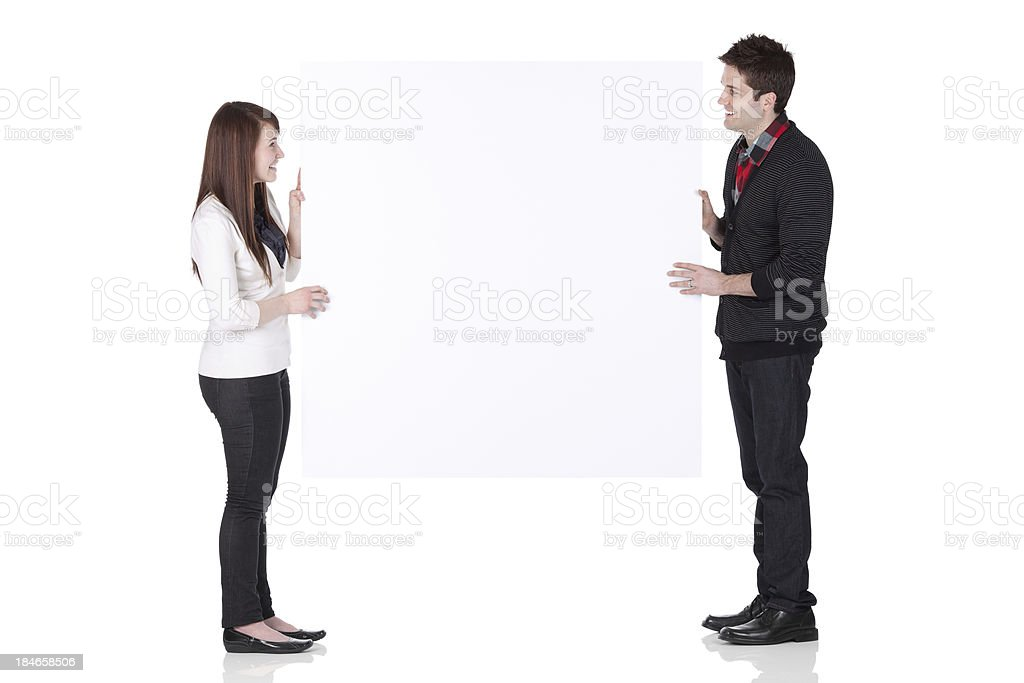 Couple holding a placard royalty-free stock photo