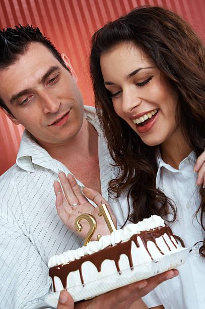 Couple Holding Birthday Cake stock photo