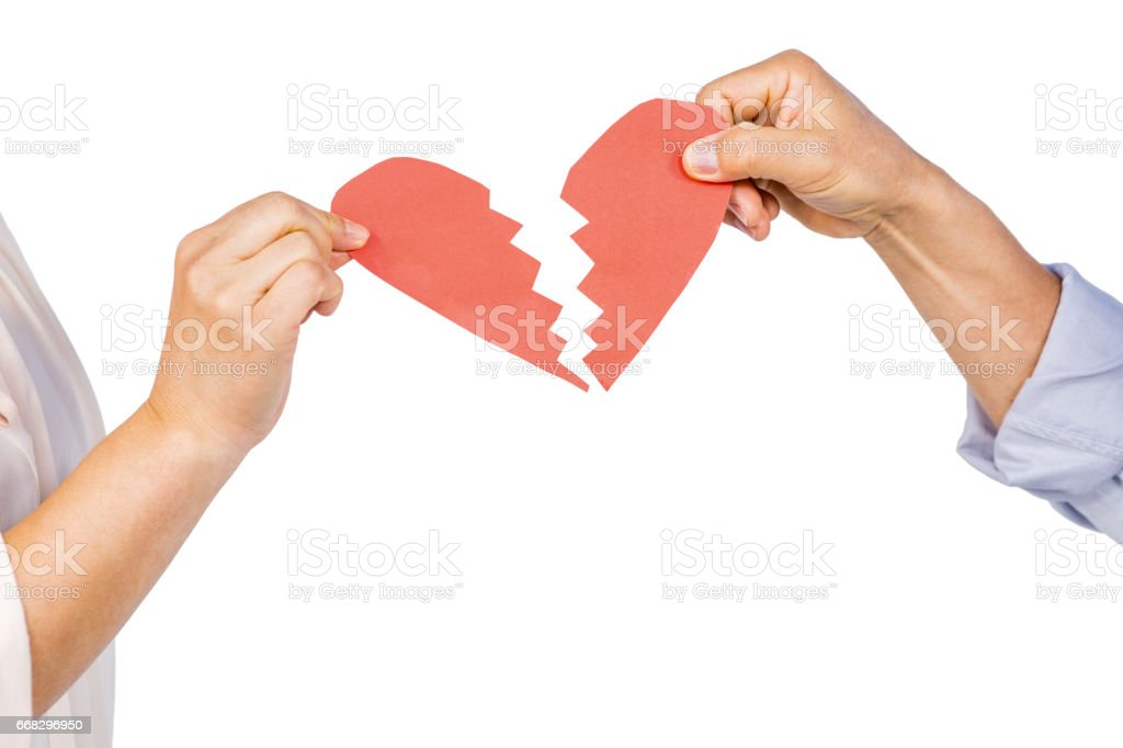 Couple holding broken heart stock photo