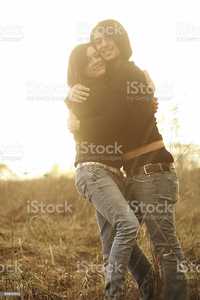 Couple Holding Each other During Sunset Portrait royalty-free stock photo