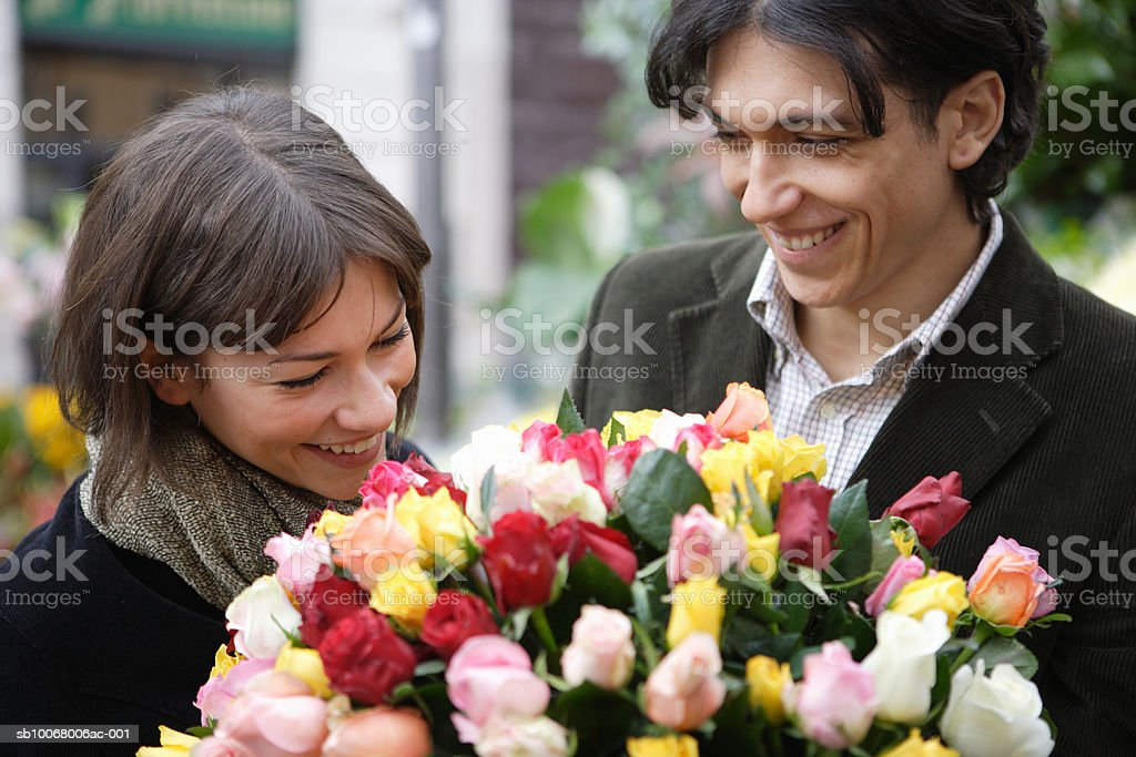 Couple holding flower bouquet royalty-free stock photo
