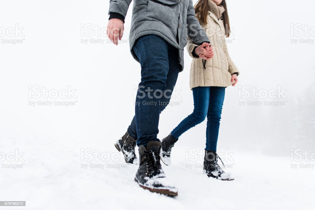 Couple holding hand in hand, cropped image. stock photo