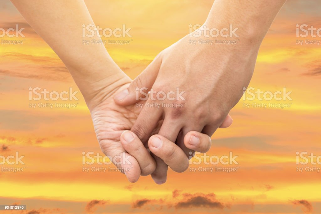 Couple Holding Hands at Sea. (Soft focus) royalty-free stock photo