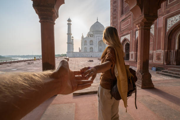 Couple holding hands at the Taj Mahal, India stock photo