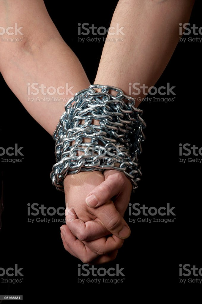 Couple holding hands, chained together. royalty-free stock photo