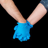 istock Couple Holding Hands During A Pandemic 1212619645