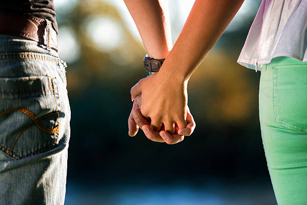 couple holding hands - love at first sight stock photos and pictures