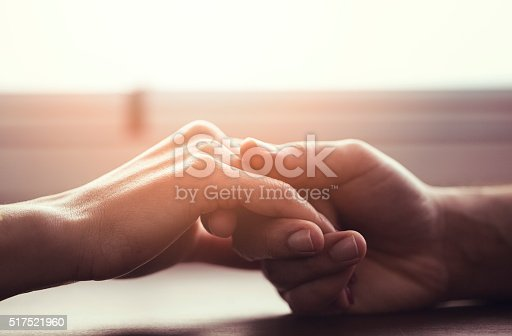 istock Couple holding hands 517521960