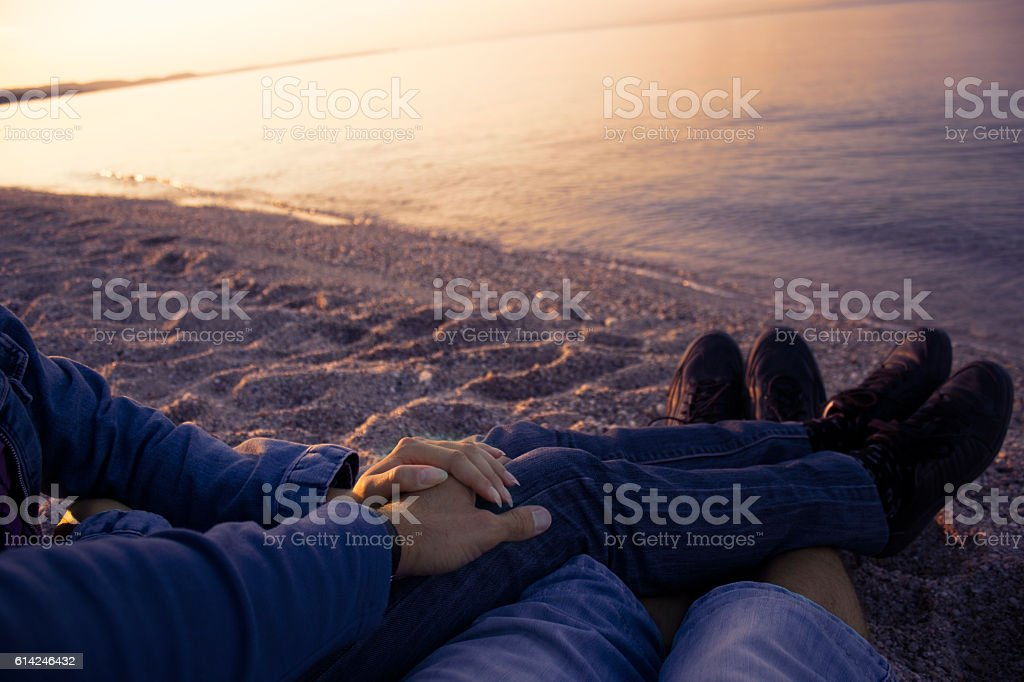 Couple holding hands. Romantics. Reflecting on their love stock photo