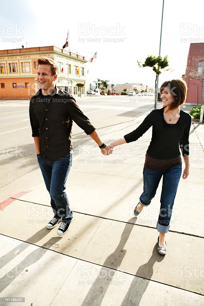 Couple Holding Hands Taking a Walk royalty-free stock photo
