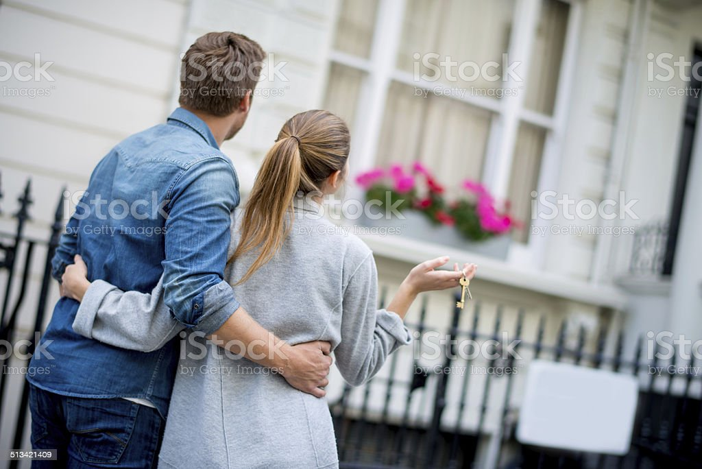Couple holding house keys stock photo