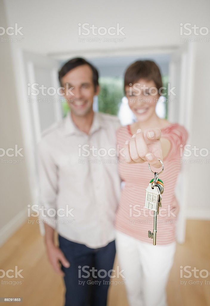 Couple holding house keys royalty-free stock photo