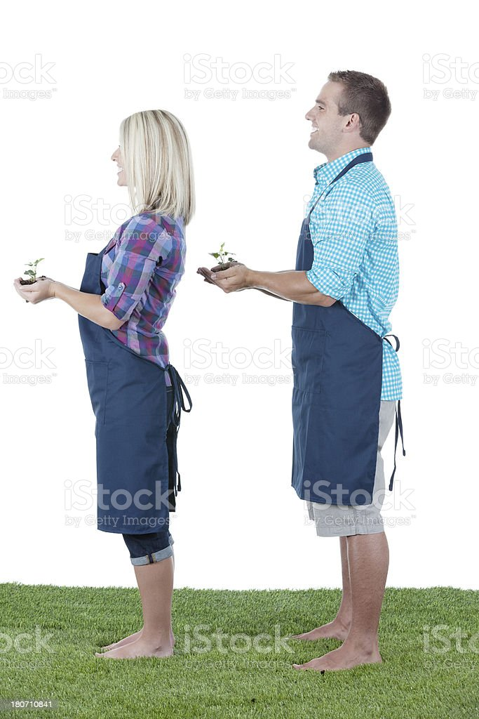 Couple holding seedlings royalty-free stock photo