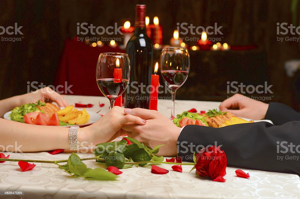 Couple holding their hands stock photo