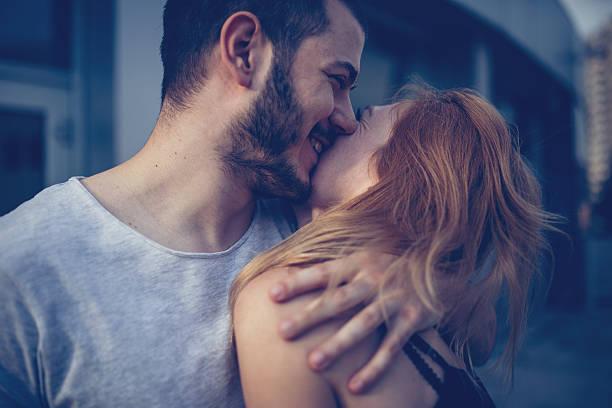 Couple hug and kiss stock photo