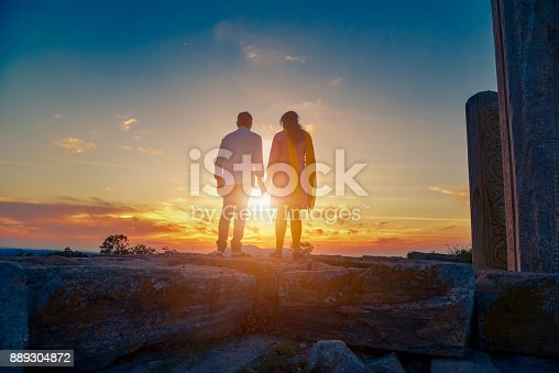 istock Couple Hugging From Behind 889304872