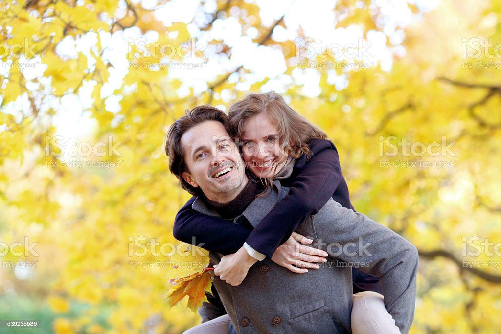 Couple hugging in autumn park royalty-free stock photo