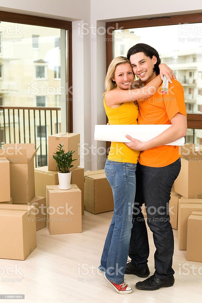 Couple hugging in new house royalty-free stock photo